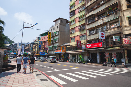 Keelung, Taiwan - September 5, 2018: Street view of Keelung city, ordinary people walk along the street