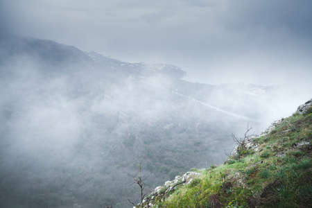 Foggy mountain landscape at cold morning, Foros district in spring. Crimea, Black Sea coast