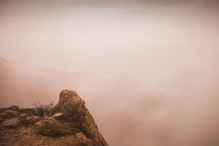 Foggy mountain landscape, warm tonal correction filter effect. Foros district in spring. Crimea, Black Sea coast