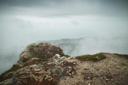 Foggy mountain landscape, Foros district in spring morning. Crimea, Black Sea coast. Vintage tonal correction filter effect