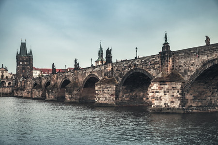 Charles Bridge in old Prague. Czech Republic. Vintage stylized photo with blue tonal filter