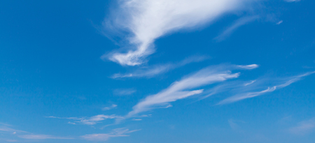 Blue sky with windy cirrus clouds at daytime. Natural panoramic background photo texture 스톡 콘텐츠