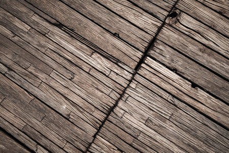 Old dark brown outdoor wooden floor, background photo texture Фото со стока