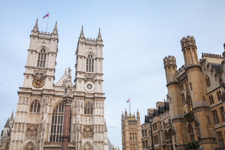 Westminster Abbey facade under light blue sky. One of the most popular landmarks of London, United Kingdom