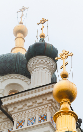Golden domes of the Church of Christs Resurrection. It is a popular tourist attraction on the outskirts of Yalta, Crimea