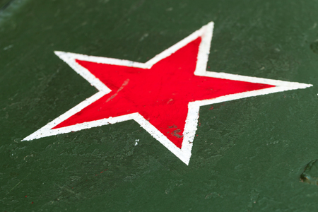 Red star with white border on green steel plate. Sign of Soviet Workers and Peasants Red Army on tank body from World War II period 写真素材