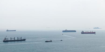 Cargo ships are in Japan Sea, Busan bay, South Korea