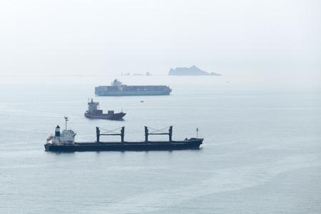 Industrial cargo ships are in Japan Sea, Busan bay, South Korea