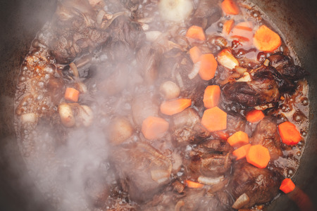Lamb with carrot and onion stew in a cauldron. Preparing of Chorba soup