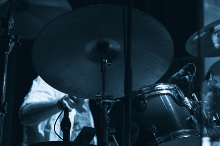 Live music photo, drum set with cymbals. Blue tonal filter effect