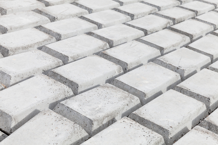 White concrete blocks. Industrial flooring background photo, modern breakwater structure