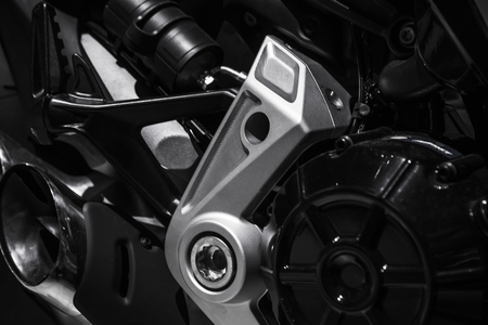 Luxury motorcycle fragment, black and metallic parts, close up photo 스톡 콘텐츠