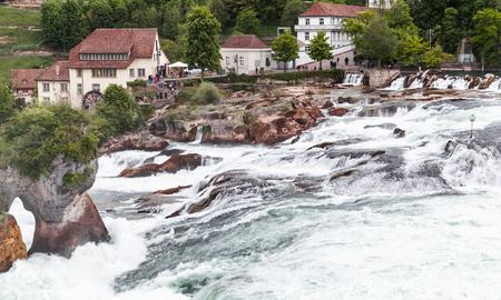 The Rhine Falls coastal landscape at cloudy spring day, Switzerland Imagens