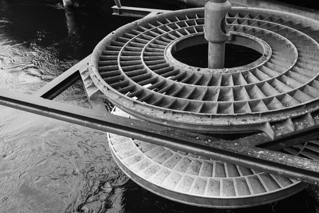 Massive water turbine on the Reuss river in Lucerne, Switzerland. Black and white photo Imagens