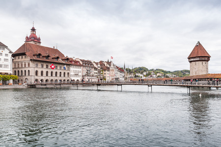 Lucerne cityscape with Chapel Bridge and ancient Water Tower. Switzerland