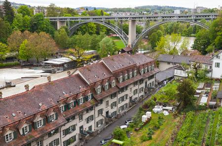Coastal Swiss town landscape with bridge. Bern, Switzerland. Aare river coast