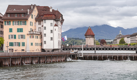 Lucerne cityscape with old dam and ancient Water Tower. Switzerland