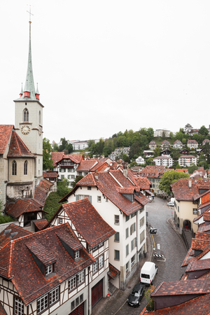 Bern old town, Switzerland. Cityscape with Nydeggkirche spire at cloudy day