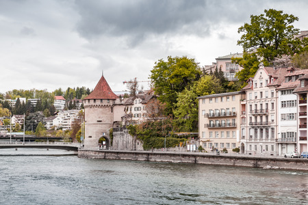 Lucerne town cityscape at cloudy day with old living houses and Nolliturm, Switzerland
