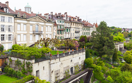 Bern, Switzerland. Landscape with old living houses and gardens at cloudy day
