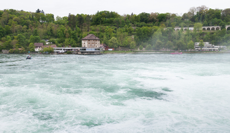The Rhine Falls landscape at cloudy day