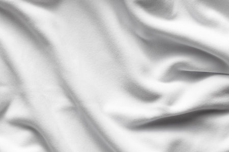 Background texture of white fleece, soft napped insulating fabric made of polyester, top view Imagens