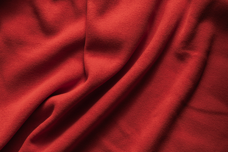 Background texture of red fleece, soft napped insulating fabric made of polyester, wavy pattern Imagens