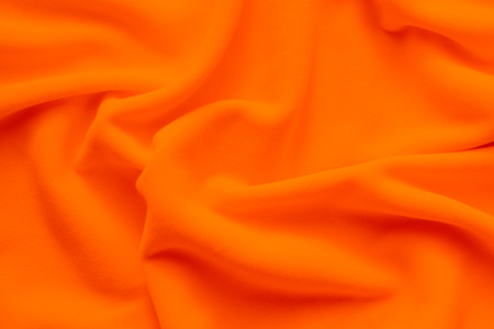 Background texture of vibrant orange fleece, soft napped insulating fabric made of polyester Imagens