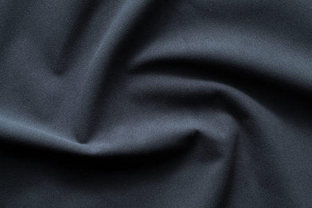 Background texture of dark blue fleece, napped insulating fabric made of polyester, wavy pattern, top view Imagens
