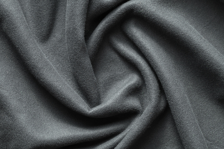 Background texture of dark gray fleece, soft napped insulating fabric made of polyester, wavy pattern, top view Imagens