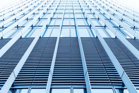 Abstract modern architecture background, office building facade perspective, wall made of steel and shiny glass