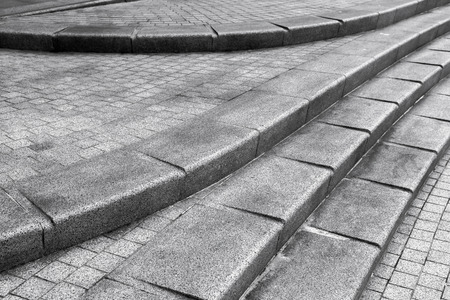 Abstract architectural fragment. Stairway made of dark gray granite stone Imagens