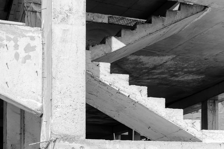Abstract industrial architecture fragment, white concrete columns and stairs under construction Imagens