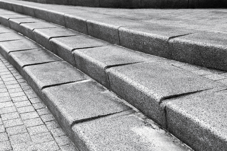 Abstract urban architectural fragment. Stairway made of dark gray granite stone