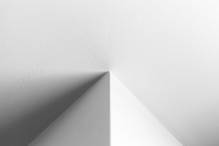 Abstract architecture background, white interior design with corner, black and white photo