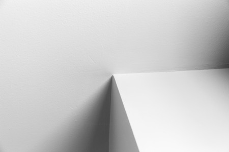 Abstract architecture background, white interior design with corner and shadows, black and white photo Banco de Imagens