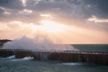 Dramatic landscape with waves on stormy sea water under evening cloudy sky. Alexandria, Egypt