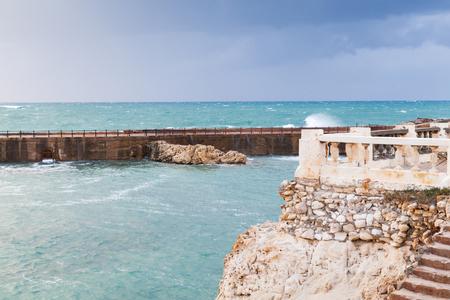 Coastal landscape with concrete breakwater in stormy sea. Alexandria, Egypt Imagens