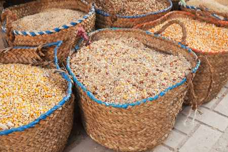 Dry corn and grains lie in baskets on the street market in Egypt