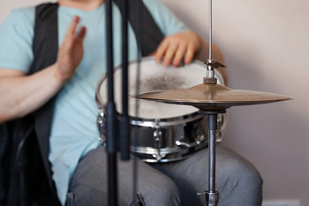 Live music background, drummer plays with hands on a snare drum