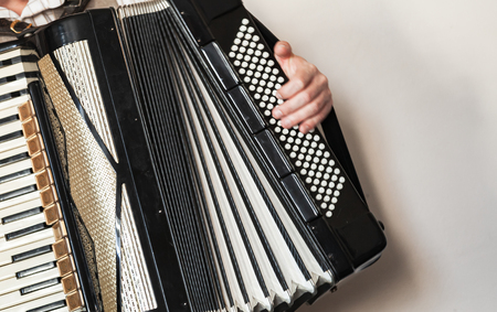 Accordionist with vintage accordion. Close-up photo with soft selective focus