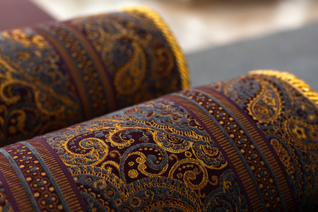 Rolled oriental carpets, close up photo with soft selective focus Archivio Fotografico