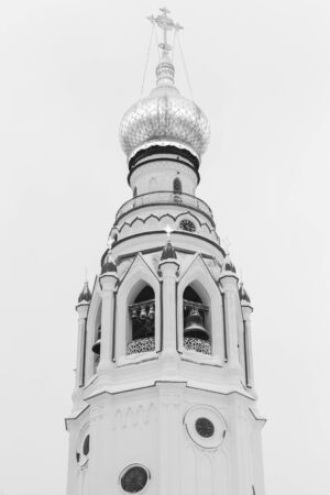 Black and white photo, bell tower of St. Sophia Cathedral, Vologda, Russia. It was built in 1869-1870
