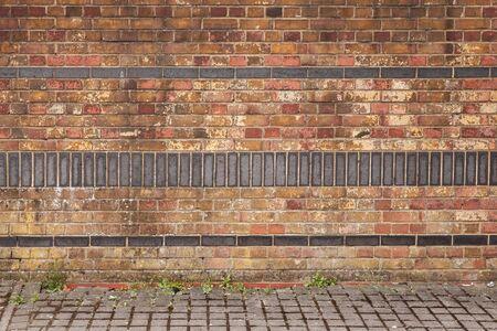 Decorative brick wall and cobblestone floor, empty urban Interior background texture
