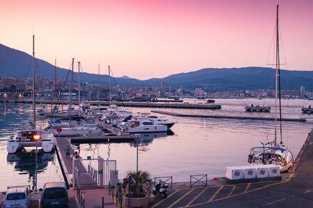 Ajaccio, France - July 6, 2015: Ajaccio Marina at sunset. Pleasure yachts and motor boats are moored in old port in Ajaccio city, Corsica island Publikacyjne