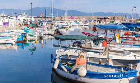Ajaccio, France - June 29, 2015: Boats are moored in old port of Ajaccio city, the capital of Corsica, a French island in the Mediterranean Sea