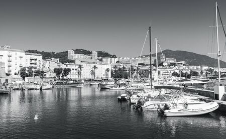 Ajaccio, France - June 30, 2015: Monochrome photo of yachts and fishing boats moored in old port of Ajaccio city, the capital of Corsica, a French island in the Mediterranean Sea Publikacyjne