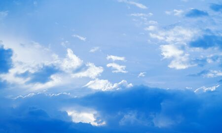Blue sky with cumulus and  clouds at daytime. 免版税图像