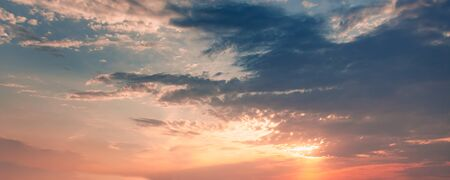 Colorful cloudy sky panorama at sunset, natural