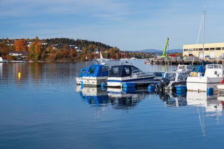 Motorboats and yachts moored in Norwegian town at sunny autumn day. Levanger, Norway